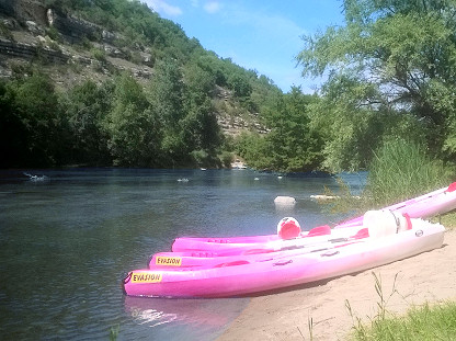 Canoes on a small beach of the Ardeche river