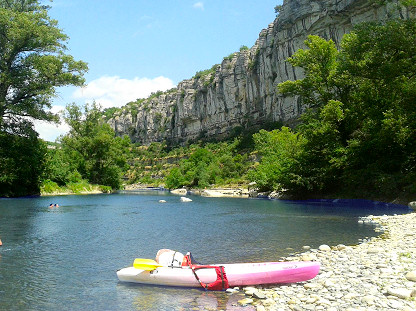 Canoeing along the water , in the gorges of Ardeche